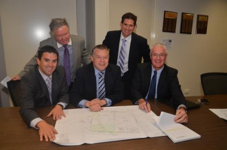 From rear, Outlook chief executive officer Tony Fitzgerald, Outlook Environmental Business manager Ross Cheesewright. From front left, Member for Gembrook Brad Battin, Minister Ryan Smith and Outlook president Edwin Hume with the plans.  127090_02 Picture: DONNA OATES